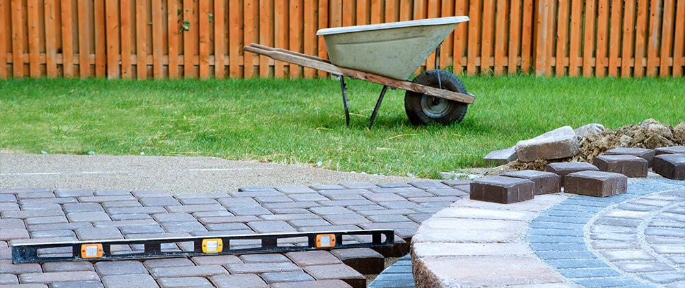 meyer landscape landscape renovation laying paving stones wheelbarrow level